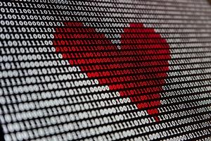 Bildschirm aus binären Codes, dem sich ein rotes Herz abzeichnet, © Photo by Alexander Sinn on Unsplash