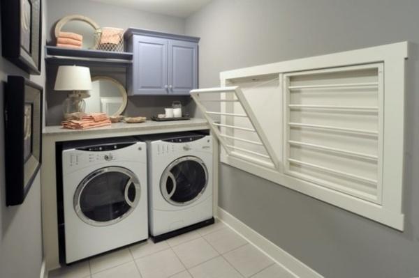 moderne Waschküche mit Waschmaschine, Trockner, © https://alleideen.com